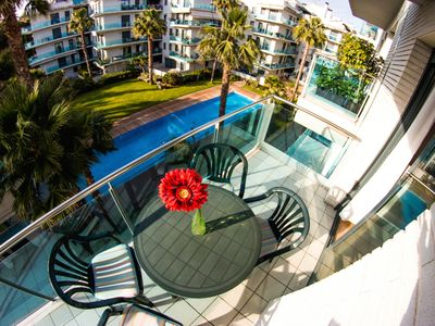 Photo for Nice apartment overlooking the pool