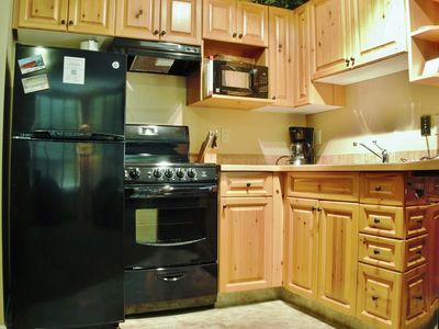 Photo for On-mountain condo with kitchen, access to outdoor pool, hot tubs & BBQ, 5min walk to ski lifts: T334