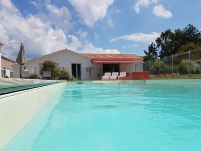 Photo for Large coastal villa with private heated pool, near the beach