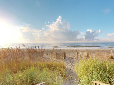 Photo for Oceanfront condo w/ shared pool/sauna/gym/game room - steps to beach!