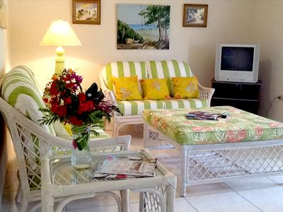 Photo for Comfortable, self-catering flat set amid a tropical garden w/ ocean view