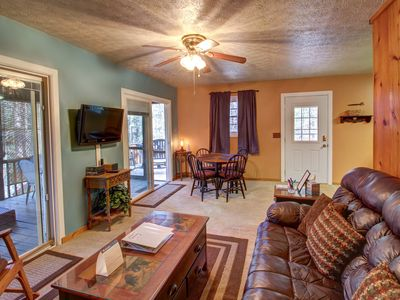 Photo for Charming cabin w/ great screened-in deck that includes hot tub and seating!