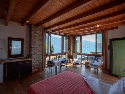 Photo for Studio rustically furnished, overlooking lake and with terrace