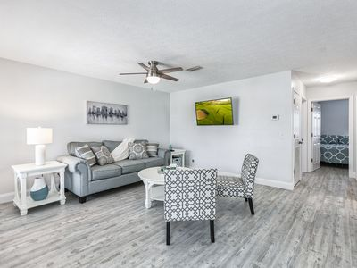 Photo for Walk to the Beach & Local Attractions! 2BR Near Shopping, Dining & Golf