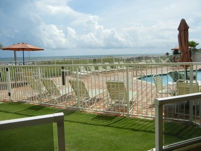View of outdoor pool from porch