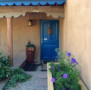 Photo for 3 blocks from the Plaza. Thick adobe walls, artisan iron work and 2 courtyards