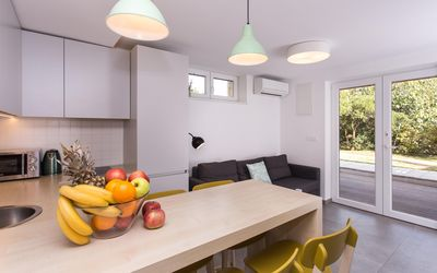 Kitchen and living room are one open space. Kitchen is fully equipped.