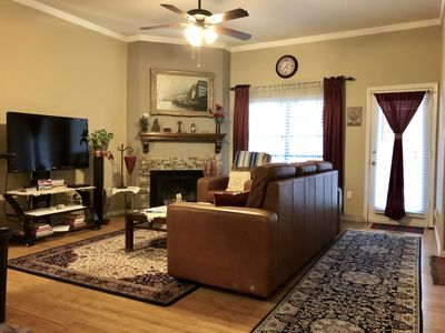 Spacious living room with custom made leather couch and recliner. Patio attached