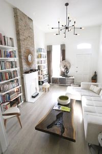 Habitat Blanc features Ethnic Modern furnishings in this historic Victorian