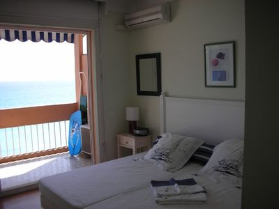 Front bedroom onto balcony and view of ocean