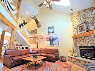 Photo for Lodge pole 4 bed town home w/ gas fireplace near Mtn House lifts, nestled in the pines.  Outdoor hot tubs, private garage, grill.