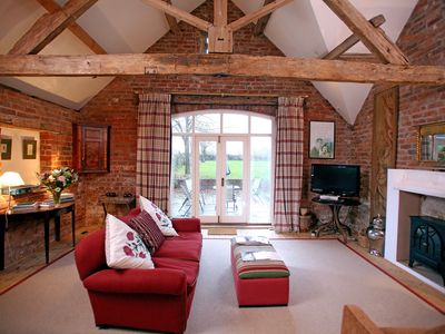 Photo for A former 19th century coach house with exposed oak beams, and terraced garden