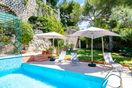 Swimming pool with garden furniture