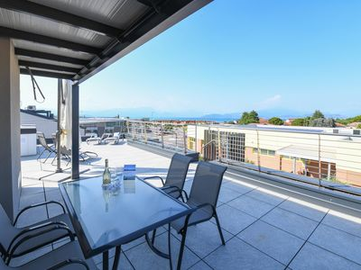 Photo for Private roof top terrasse of 70m² with lake view, 2 bed rooms and 2 bathrooms