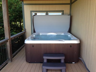 Relax in your hot tub for seven overlooking the lake