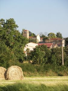 The view across the field to the village.