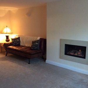 Sitting room with hole in the wall fireplace