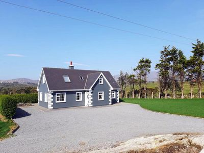 Photo for Detached cottage, in quiet location, facing south with fine views over Beare Haven to Beare Is…