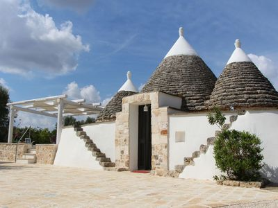 Photo for Historic trullo  with private pool in the countryside close to the sandy beaches