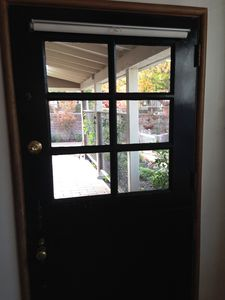 Dutch door entry to living room from loggia.