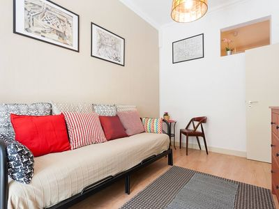 Photo for Sunny orange garden apartment in central Lisbon