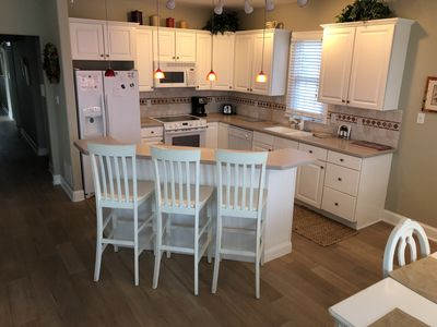 Fully equipped kitchen area with large breakfast bar