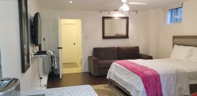 Photo for Bright and Spacious Basement Studio Suite  w Parking and steps to Subway!
