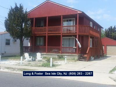 Photo for Southend duplex 2nd floor. Great beach! Features nice front porch, CENTRAL AIR, off street parking.