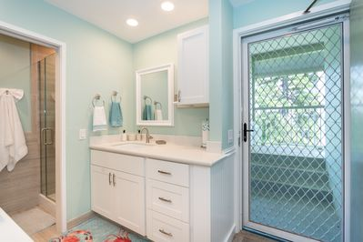 Enter into the ample bath and kitchenette area