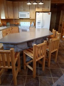 Large kitchen island with 5 log crafted chairs