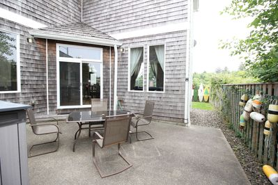 Side Patio. BBQ and fire pit are in the storage container.
