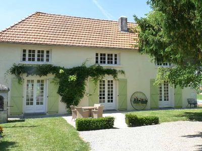 Photo for French Farmhouse set in 8 acres with heated pool