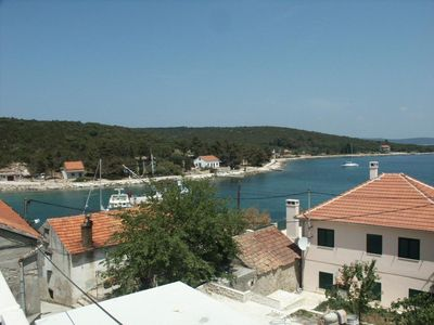 Photo for Two bedroom apartment with terrace and sea view Žman, Dugi otok (A-891-a)