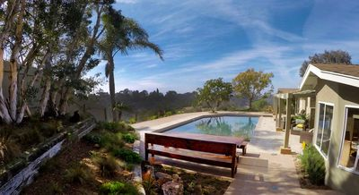 Photo for 4BR/3Ba HEATED Pool/spa, Views, Min to Beaches/Trails, secluded property/ lawns