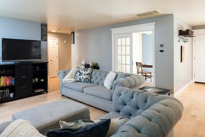 """light and bright """"Pottery Barn"""" living room with office behind"""
