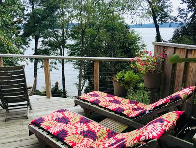 Upper deck w/ incredible river views. Chaise lounges + chairs, bbq, dining set.