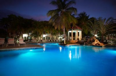 Back pool & jacuzzi lights up the night...  Aruba offers perfect temps for a dip after dark.