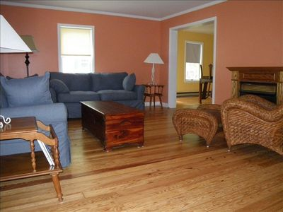 The FAMILY ROOM features restored 1920s eastern pine floors and a gas fireplace!