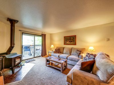 Photo for Centrally located condo w/ gas grill & wood fireplace - walk to town/the lake!
