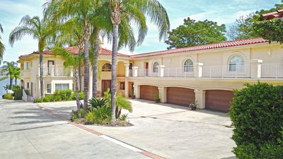 Photo for Sleeps 60+ 8500 sqft Mansion on Lake Water Front w/Private Large Beach.
