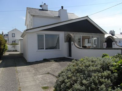 Photo for Bright modern holiday cottage steps from the beach and in the heart of village