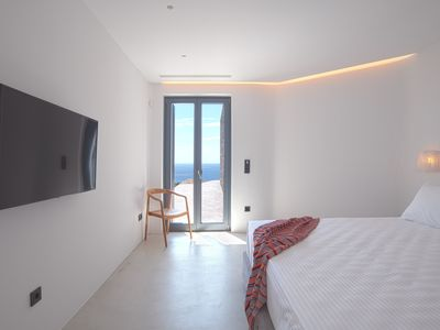 Photo for Brand new villa Agate, right above sandy beach of Kalafatis with infinity pool