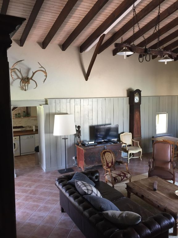 Cazideroque farmhouse rental grange sitting room leading to kitchen