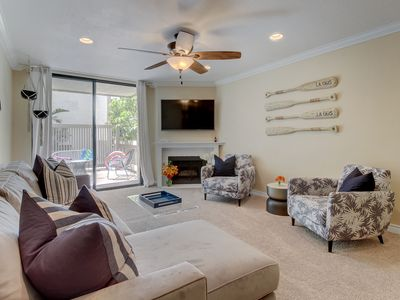 Photo for Gated condo w/ shared pool, hot tub, gym & putting green - walk to the beach!