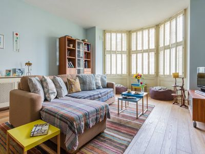 Photo for Charming 3BR Garden Flat In SW London
