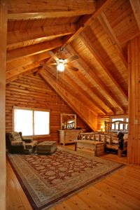 Master suite, tall view.  Huge beam ceilings and beautiful wood all around.