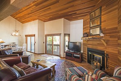 Wood Burning Fireplace Centers the Living Room  TV with Expanded Cable and DVR