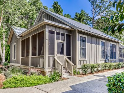 Photo for Beautiful cottage by the beach w/ a shared outdoor pool, dock, & boat access!