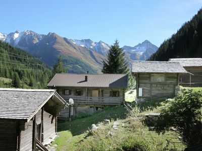 Photo for An attached chalet in the mountains complete with grazing cattle.