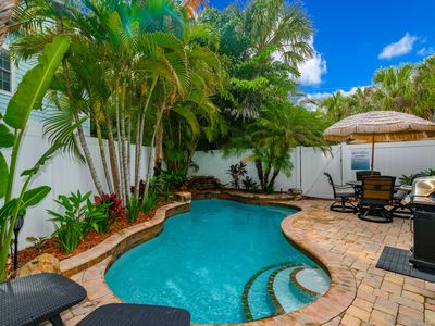 Private heated salt pool at OHasis Getaway II and only 210 steps from the Beach!